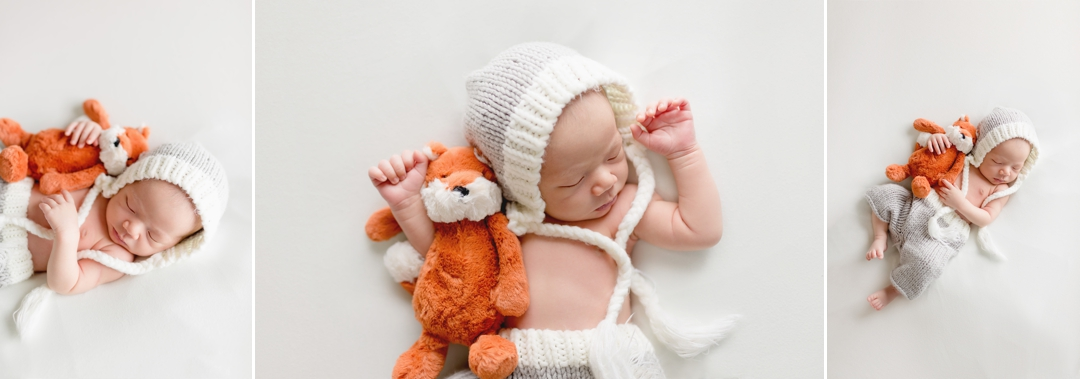 Newborn baby with jellycat fox stuffed animal in knit outfit