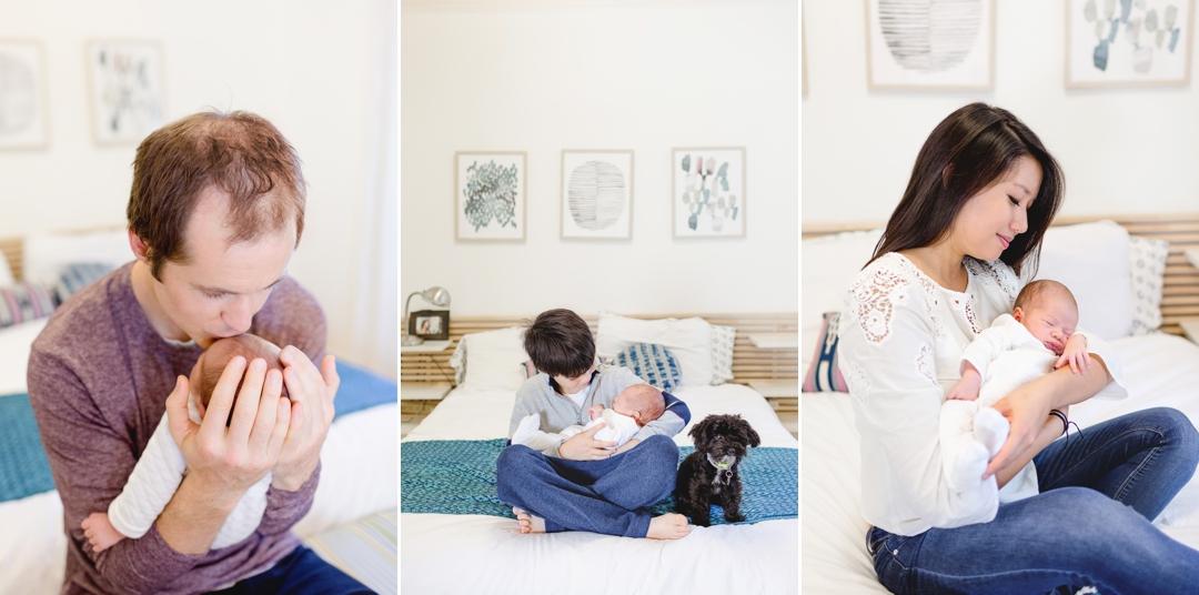 Family loving on their newborn baby